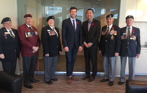 Mayor Don Iveson receiving a poppy.